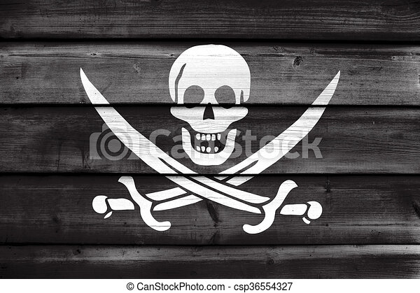 Calico Jack Pirate Flag, painted on old wood plank background - csp36554327