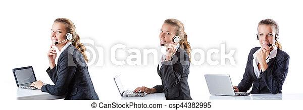 Call center assistant responding to calls - csp44382995