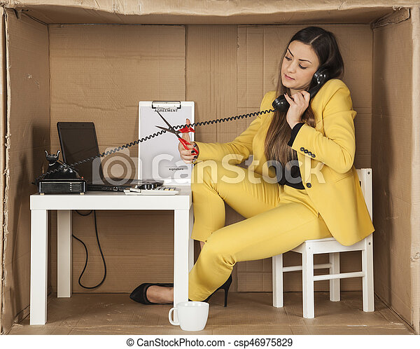 call center employee cuts the cable from the phone handset, during a telephone conversation - csp46975829