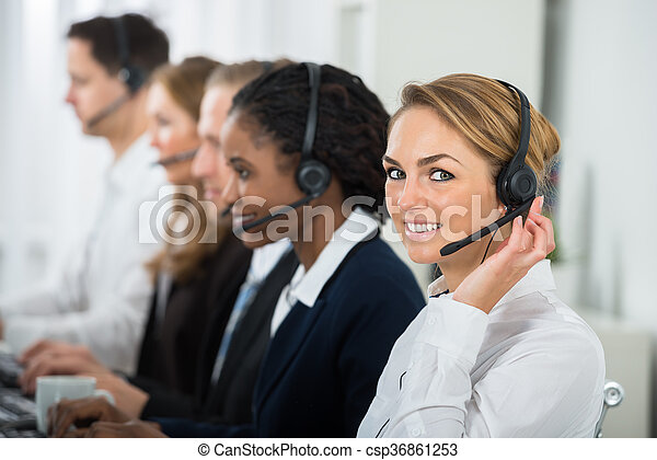 Call Center Operators In Office - csp36861253