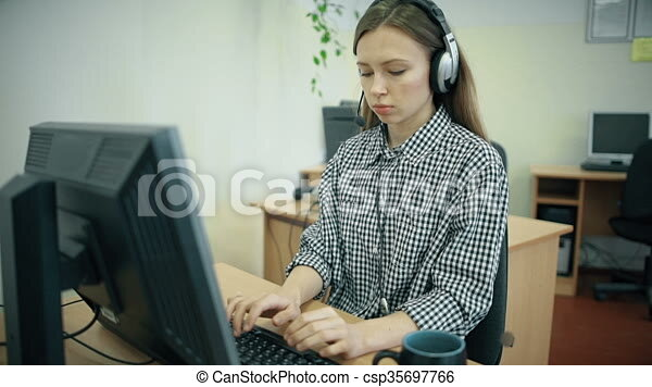 N Call Centre Agents Working In Their Bright Office