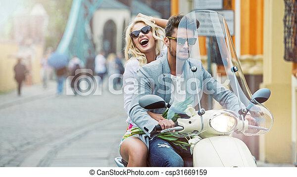 Calm boyfriend giving his girlfriend a lift  - csp31669159