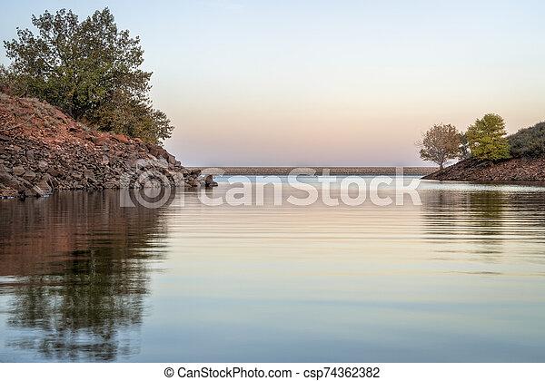 calm dusk over mountain lake - csp74362382