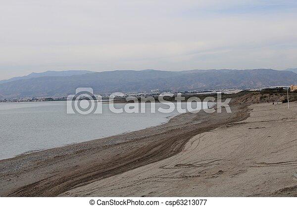 Calm sea and sandy beach - csp63213077