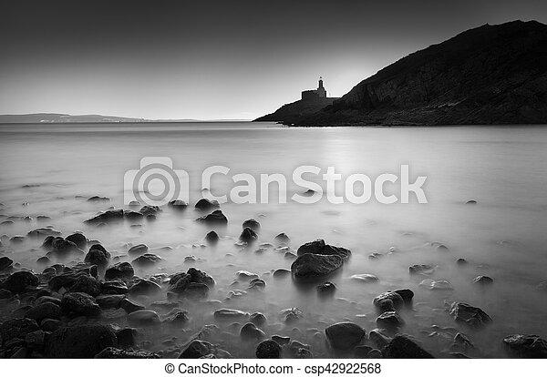 Calm sea at Mumbles lighthouse - csp42922568