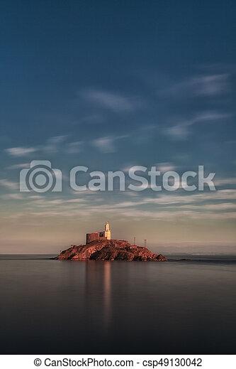 Calm sea at Mumbles lighthouse - csp49130042