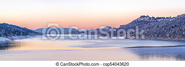 calm winter dusk over mountain lake - csp54043620