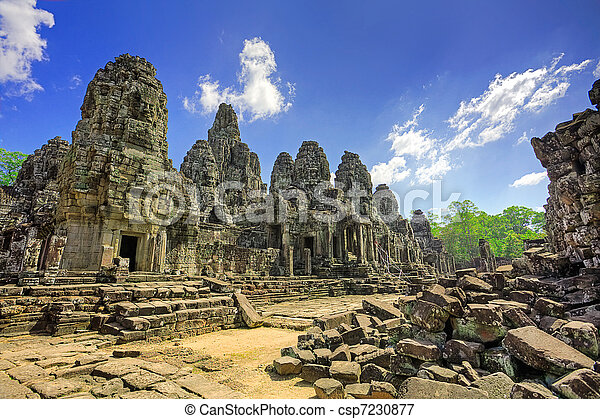 Cambodian temple ruins turning to rubble, blue sky background - csp7230877