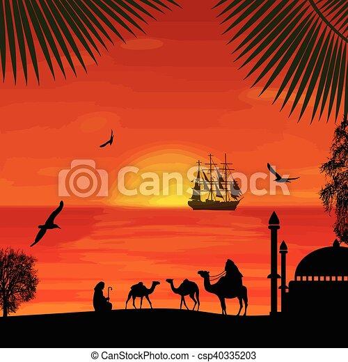 Camel caravan at beautiful sunset on the beach - csp40335203