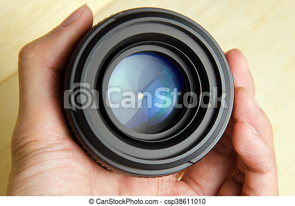 Camera dslr lens with hand holding - csp38611010