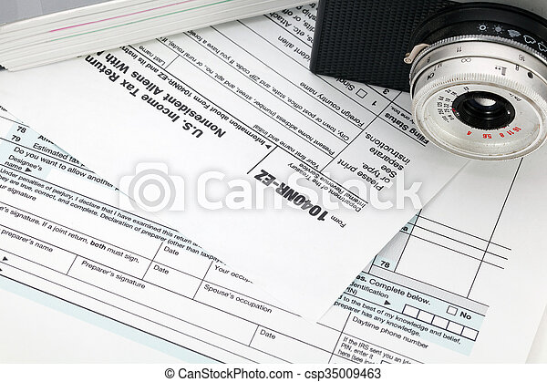 Camera on tax form background - csp35009463