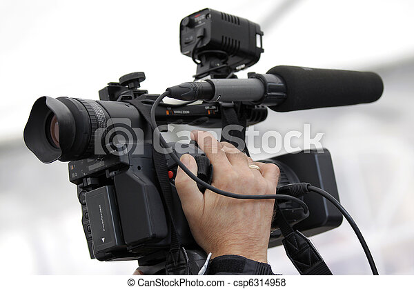 Cameraman and video camera - csp6314958