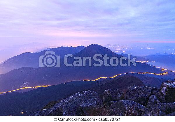Montaña por la noche con carretera - csp8570721