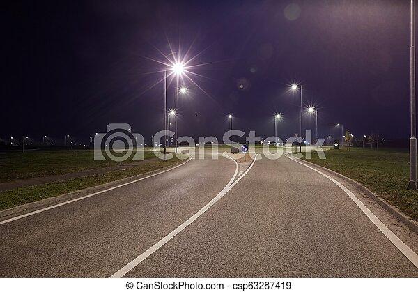 Camino por la noche - csp63287419