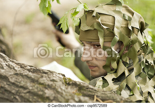Camouflaged military man - csp9572589