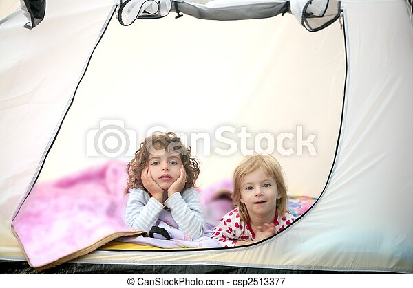 Camping tent vacation with two little girls - csp2513377
