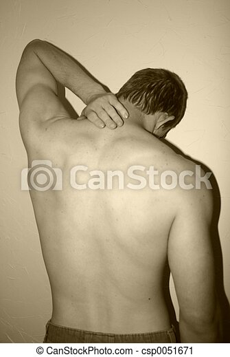 Young man trying to massage away pain in his neck