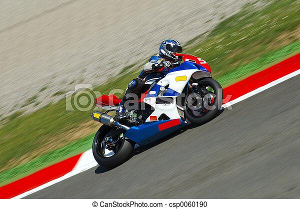 A motorbike racing, visible panning