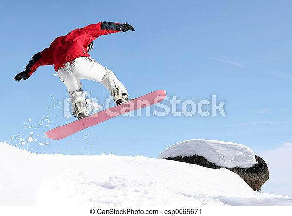 Snowboarder jumping - csp0065671
