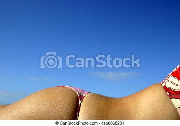 Girl sunbathing in bikini with blue sky