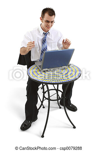 Business Man At Bistro Table With Working On Laptop