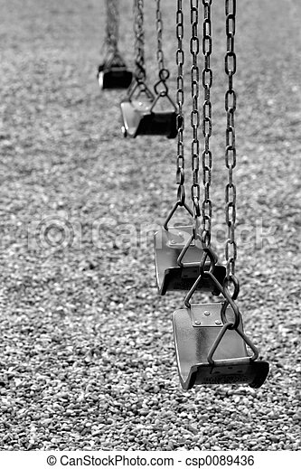 playground swings in black and white - csp0089436