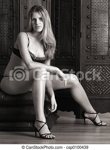 Woman sitting in her lingerie - csp0100439