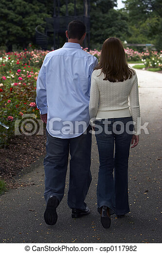 Romantic stroll of a couple in the flowers - csp0117982