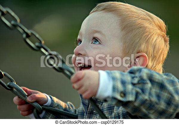 cute boy on swing - csp0129175