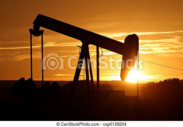 oil pump against setting sun - csp0129204