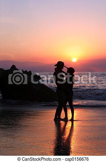 Couple at sunset - csp0156676