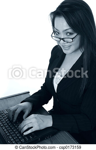 Secretary typing on laptop - csp0173159