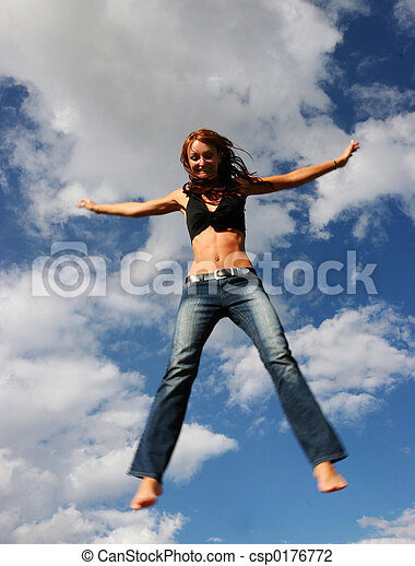 Woman jumping of joy - csp0176772