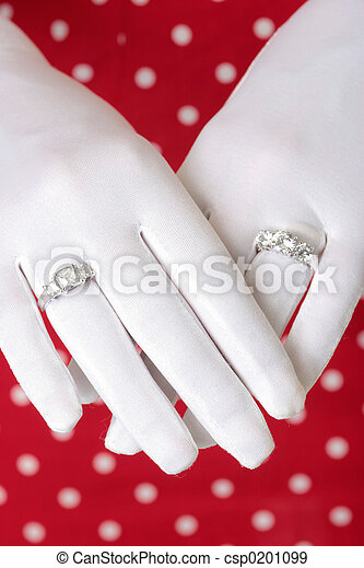 woman showing hands wearing two diamond rings