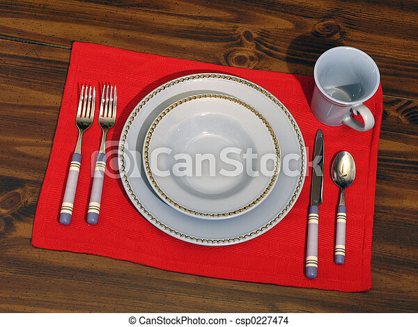 Stock Photo of Place Setting - Dining place setting on a red mat and wood...