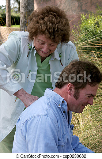 Mother Gives Backrub to Son - csp0230682