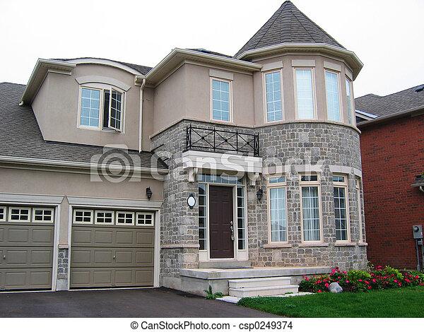 Photo de maison pierre stuc taupe pierre et stuc for Maison en stuc