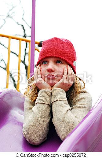 Girl on playground thinking - csp0255072