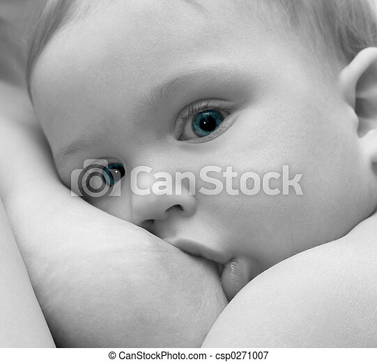 A newborn baby breastfeeding
