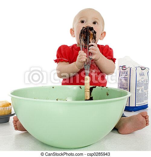 Baby Licking Cake Mixer - csp0285943