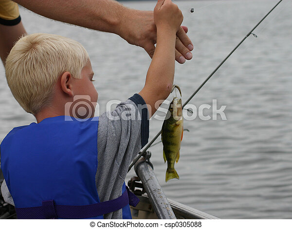 Young Boy Fishing caught a fish dad helping