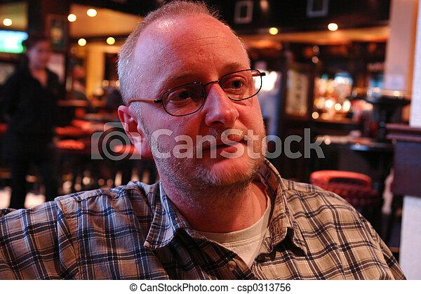 Man in pub - csp0313756