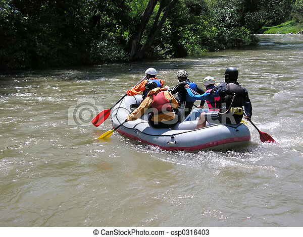 Five people in a rafting boat, rowing on the river