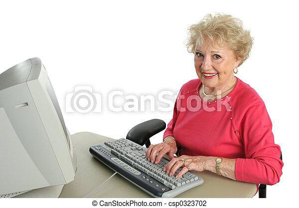 Senior Lady Enjoys Computer - csp0323702