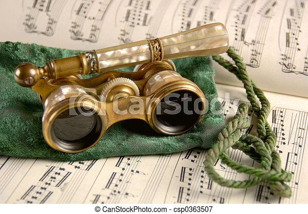 Antique Opera Glasses on Sheet Music - csp0363507