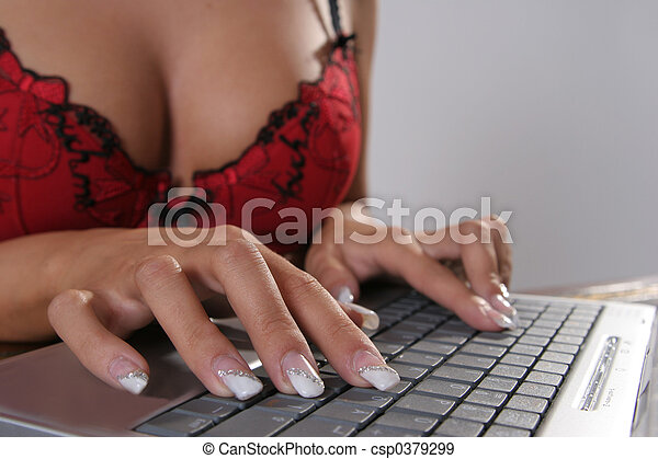 Stock Photographs of Hot office Lady writing in bra on a