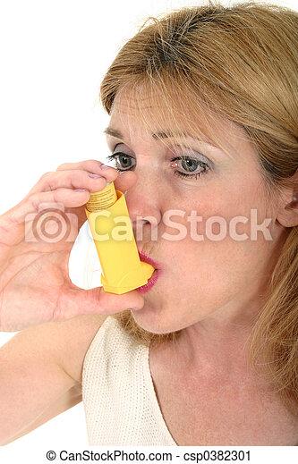 Woman Using Asthma Inhaler 3 - csp0382301