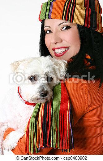Female cuddling a pet dog - csp0400902