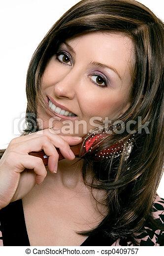 Haircare - Female using a hairbrush - csp0409757
