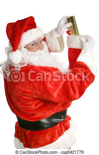 Santa Stuffing Stockings - csp0421779